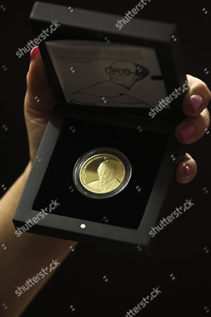 A Woman Holds a Case Containing a Gold Coin in Honor of the Portuguese Writer and Recipient of the 1998 Nobel Prize in Literature Jose Saramago who Died in 2010 is Seen During the Presentation at Jose Saramago Foundation in Lisbon Portugal 22 May 2013 Portugal Lisbon