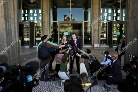British Gerry Mccann (c-r) and Kate Mccann (c-l) the Parents of Their Missing Daughter Madeleine Talk to the Press After a Court Session in the Libel Case Against Former Portuguese Police Chief Goncalo Amaral (not Pictured) at Lisbon's Palace of Justice in Lisbon Portugal 08 July 2014 Portugal Lisbon