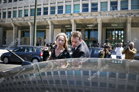 British Gerry Mccann (c-r) and Kate Mccann (c-l) the Parents of Their Missing Daughter Madeleine Leaving the Courthouse After a Court Session in the Libel Case Against Former Portuguese Police Chief Goncalo Amaral (not Pictured) at Lisbon's Palace of Justice in Lisbon Portugal 08 July 2014 Portugal Lisbon