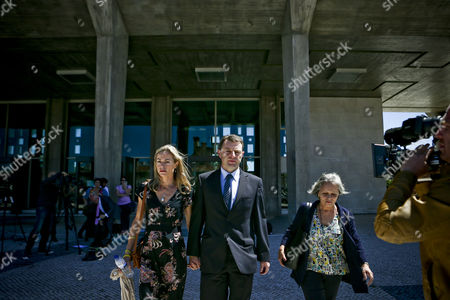 Gerry Mccann (r) and Kate Mccann (l) the Parents of the Missing British Child Madeleine Leaving the Courthouse After a Court Session For the Libel Case Against Former Portuguese Police Chief Goncalo Amaral (not Pictured) at Lisbon's Palace of Justice in Lisbon Portugal 08 July 2014 Portugal Lisbon