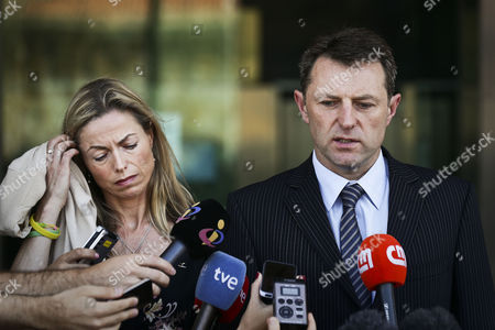 Stock Photo of Gerry Mccann (r) and Kate Mccann (l) the Parents of the Missing British Child Madeleine Talk to the Press After a Court Session For the Libel Case Against Former Portuguese Police Chief Goncalo Amaral (not Pictured) at Lisbon's Palace of Justice in Lisbon Portugal 08 July 2014 Portugal Lisbon