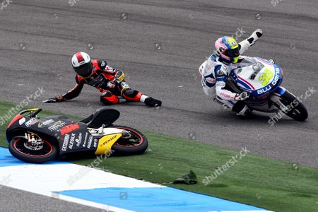 Japanese Hiroki Ono (l) From Caretta Technology Team and Spanish Sergio Gadea From Blusens by Paris Hilton Racing Crash During 125cc Qualifying Session at Estoril Circuit Near Lisbon Portugal 30 April 2011 the Portuguese Grand Prix Will Take Place Tomorrow 01 May Portugal Estoril