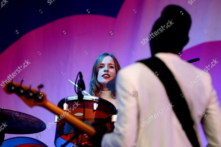 Stock Image of Drummer Anna Prior (back) of British Electronic Band Metronomy Performs During the 20th Super Bock Super Rock Festival in Meco Sesimbra Portugal 17 July 2014 the Music Event Runs From 17 to 19 July Portugal Sesimbra