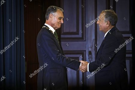 Stock Image of Portugal's President Marcelo Rebelo De Sousa (r) Honors Portugal's Former President Anibal Cavaco Silva (l) with the Order of Freedom in Lisbon Portugal 09 March 2016 Portugal Lisbon