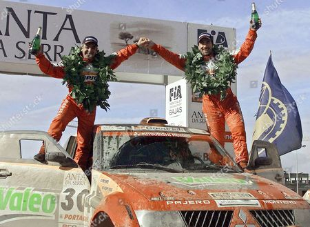 Rally Pilot Luc Alphand and Navigator Gilles Picard (l) Both of France Celebrate After Winning the Rally Baja Portalegre in Their Mitsubishi Evolution in Portalegre Alentejo Region South of Portugal Sunday 23 October 2005 Portugal Portalegre