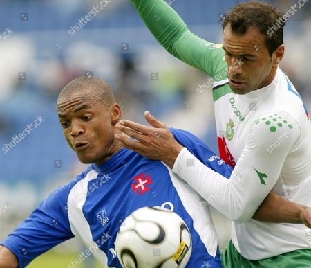 Belenenses' Meyong (l) Fights For the Ball with Vitoria Setubal's Ricardo Chaves During Their Portuguese League Match at the Restelo Stadium in Lisbon 14 April 2006 Portugal Lisbon
