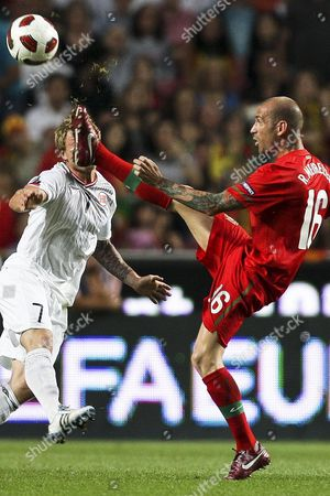Portuguese Soccer Player Raul Meireles (r) Fights For the Ball with Norway's Bjorn Helge Riise (l) During Their Group H Euro 2012 Qualifying Match 04 June 2011 at Luz Stadium in Lisbon Portugal Portugal Lisbon