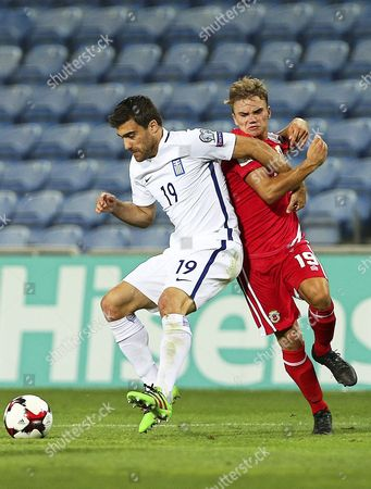 Greece's Sokratis Papastathopoulos (l) in Action Against Gibraltar's James Coombes (r) During the Fifa World Cup 2018 Qualifying Soccer Match at Algarve Stadium in Faro Southern Portugal 06 September 2016 Greece Won 4-1 Portugal Faro
