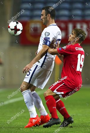 Stock Photo of Greece's Vasileios Torosidis (l) in Action Against Gibraltar's James Coombes (r) During the Fifa World Cup 2018 Qualifying Soccer Match at Algarve Stadium in Faro Southern Portugal 06 September 2016 Greece Won 4-1 Portugal Faro