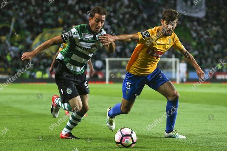 Sporting Cp Player Joao Pereira (l) in Action Against Estoril Praia Player Joel Ferreira During the Portuguese First League Soccer Match at Alvalade Stadium in Lisbon Portugal 23 September 2016 Portugal Lisbon