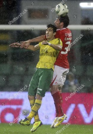 Benfica Player Joan Capdevila (r) of Spain Fights For the Ball with Naval´s Joao Pedro During the Portuguese Cup Soccer Match Held at Figueira Da Foz Stadium in Figueira Da Foz Portugal 18 November 2011 Portugal Figueira Da Foz