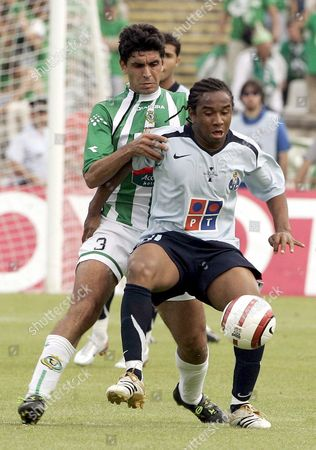 Fc Porto Player Anderson (front) Fights For the Ball Together with Vitoria Setubal's Ricardo Chaves During Their Portugal Cup Final Match Played Today's Sunday 14 May 2006 at the National Stadium in Lisbon Portugal Lisbon