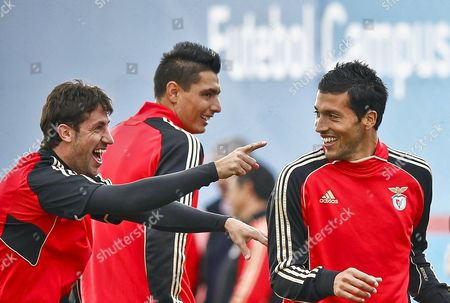 Benfica Players (l-r) Joan Capdevila Oscar Cardozo and Ezequiel Garay Joke During Their Team's Training Session in Seixal Portugal 06 December 2011 Benfica Will Face Otetul Galati in the Uefa Champions League Soccer Match on 07 December Portugal Seixal
