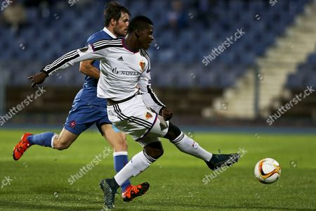 Joao Amorim (l) of Belenenses Vies For the Ball with Breel Embolo of Fc Basel During Their Uefa Europa League Group i Match Held at Restelo Stadium in Lisbon Portugal 05 November 2015 Portugal Lisbon