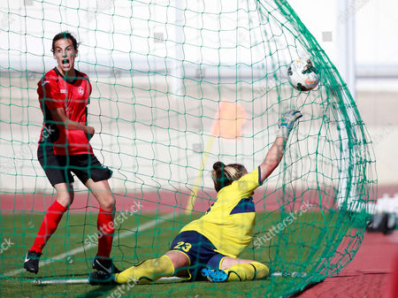 Clube Atletico Ouriense Player Flavia Fartaria (l) Reacts to a Goal From Teammate Mariana Coelho (not Pictured) Against Goalkepper Hanit Schwarz From Asa Tel-aviv University Sc During Their Uefa Women's Champions League Qualifying Round Soccer Match Held in Fatima Stadium 11 August 2014 Portugal Fatima