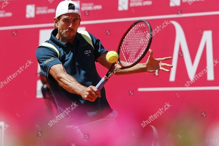Stock Picture of Guillermo Garcia of Spain in Action Against Michael Berrer of Germany During Their First Round Match For the Estoril Open Tennis Tournament in Estoril Portugal 26 April 2016 Portugal Estoril