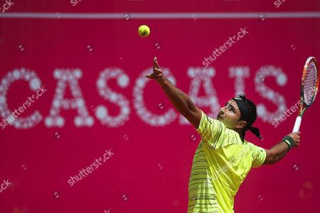 Australia's Marinko Matosevic Serves the Ball to France's Richard Gasquet During Their First Round Match of the Estoril Open 2015 Tennis Tournament at Estoril Tennis Club in Estoril Portugal 28 April 2015 Portugal Estoril