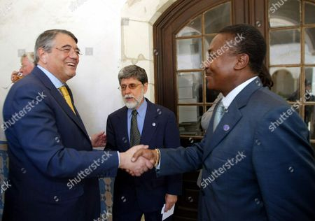 Portuguese Foreign Minister Martins Da Cruz (l) and His Sao Tome and Prince Counterpart Mateus Meira Rita (r) Shake Hands As Brazilian Foreign Minister Celso Amorim Looks on During Viii Foreign Ministers Meeting of Portuguese Official Language Countries (cplp) Today 17 July 2003 Epa Photo/lusa/paulo Novais Portugal Coimbra