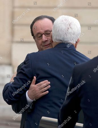"""President Francois Hollande, left, greets Palestinian leader Mahmoud Abbas upon his arrival at the Elysee Palace prior to their meeting in Paris, France,. Saeb Erekat, secretary general of the Palestinian Liberation Organization, has told The Associated Press that Israeli legislation to retroactively legalize thousands of West Bank settlement homes is """"putting the last nail in the coffin of the two-state solution"""