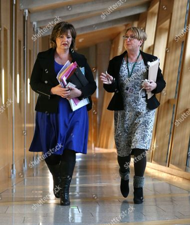 Fiona Hyslop, Cabinet Secretary for Culture, Europe and External Affairs, and Annabelle Ewing, Minister for Community Safety and Legal Affairs, make their way to the Debating Chamber