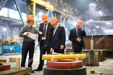 Former NATO Secretary General Lord Robertson of Port Ellen (2nd right) joins Gareth Snell (2nd left) on a tour of Goodwin Group plc in the constituency of Stoke-on-Trent Centre
