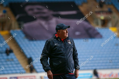 It looks like Jimmy Hill is looking down on Coventry City Manager Russell Slade  during the EFL Trophy semi final match between Coventry City and Wycombe Wanderers at the Ricoh Arena, Coventry