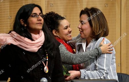 Stock Image of Kshama Sawant, Debora Juarez Seattle City Council member Debora Juarez, right, is embraced by Rachel Heaton, a Muckleshoot tribal member, as Council member Kshama Sawant stands nearby after Heaton gave both women gifts from the Native American community before a Council meeting, in Seattle. The City Council is scheduled to vote on whether to divest $3 billion in city funds from Wells Fargo over its funding of the Dakota Access Pipeline