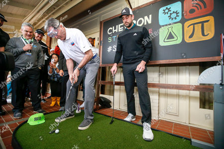 John Watson, Aaron Rogers Chevron CEO John Watson, left, putts on an indoor putting green with Green Bay Packers quarterback Aaron Rogers, right, during the Chevron's 7th annual $100,000 Shoot-Out in the Champions vs Champions to kick off the AT&T National Pro-Am golf tournament, in Pebble Beach, Calif. Since 2013, Chevron has provided over $500,000 to local nonprofits and education organizations through this event