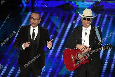 Carlo Conti with the comedian Ubaldo Pantani during the imitation of Bob Dylan