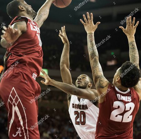 Stock Picture of Justin McKie, Shannon Hale, Ar'Mond Davis South Carolina guard Justin McKie (20) attempts shoots against Alabama's Shannon Hale (11) and Ar'Mond Davis (22) during the first half of an NCAA college basketball game, in Columbia, S.C