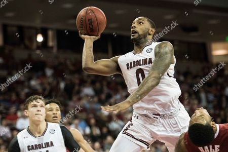 Stock Image of Sindarius Thornwell, Shannon Hale South Carolina guard Sindarius Thornwell (0) shoots over Alabama forward Shannon Hale, right, during the second half of an NCAA college basketball game, in Columbia, S.C. Alabama defeated South Carolina 90-86