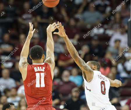 Crimson Tide forward Shannon Hale (11) shoots a three point basket over Gamecocks guard Sindarius Thornwell (0) in the NCAA Basketball matchup at Colonial Life Arena in Columbia, SC