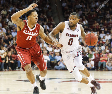 Gamecocks guard Sindarius Thornwell (0) drives to the basket against Crimson Tide forward Shannon Hale (11) in the NCAA Basketball matchup at Colonial Life Arena in Columbia, SC