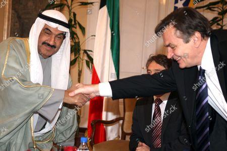 Prime Minister of Kuwait Sheikh Nasser Mohammed Al-ahmed Al-sabah (l) Shake Hands with Member of the Bosnia-herzegovina's Presidency Haris Silajdzic (r During Kuwaiti Prime Minister Official Visit to Sarajevo Bosnia and Herzegovina On 24 November 2009