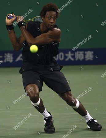 French Gael Montfils Returns a Ball in His Match Against Compatriot Paul-henri Mathieu During the Shanghai Atp Masters 1000 China 13 October 2009