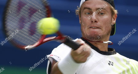 Australian Lleyton Hewitt Returns a Ball in His Match Against French Gael Montfils During the Shanghai Atp Masters 1000 Shanghai China 14 October 2009