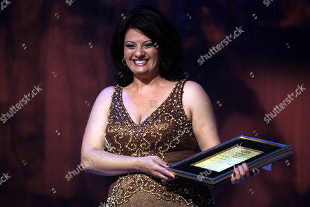 Palestinian Director Cherien Dabis Holds Her Prize After Winning the Best Arabic Film Award For 'Amreeka' at the Closing Ceremony of the 33rd Cairo International Film Festival Cairo Egypt On 20 November 2009