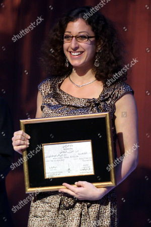 French Director Mona Achache Holds Her Prize After Winning the International Critics Award and the Silver Pyramid Special Jury Prize For 'Le Herisson' (the Hedgehog) at the Closing Ceremony of the 33rd Cairo International Film Festival in the Egyptian Capital On 20 November 2009