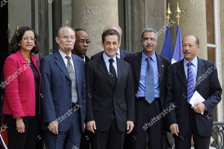 French President Nicolas Sarkozy (c) Poses For Photographs with Local Executive Presidents of Martinique and French Guyana After Their Meeting at Elysee Palace in Paris France 07 October 2009 (from L to R) French Junior Minister For Overseas Territories Marie-luce Penchard Martinique Regional Council President Alferd Marie-jeanne French Guyana General Council President Tien Liong Nicolas Sarkozy French Guyana Regional Council President Antoine Karam and Martinique General Council President Claude Lise
