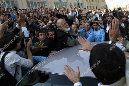 Iranian Opposition Leader Mehdi Karroubi (c) is Attacked by Supporters of President Ahmadinejad at the Press Fair in Tehran Iran On On 23 October 2009 After Seeing the Moderate Cleric Many of the Visitors Shouted Slogans in Favour of Karroubi and Opposition Leader Mir-hossein Moussavi and Against the Administration of President Mahmoud Ahmadinejad the Incident Led to Interference of Police Forces Who Entered the Fair For Putting an End to the Spontaneous Protest Gathering Epa/stringer