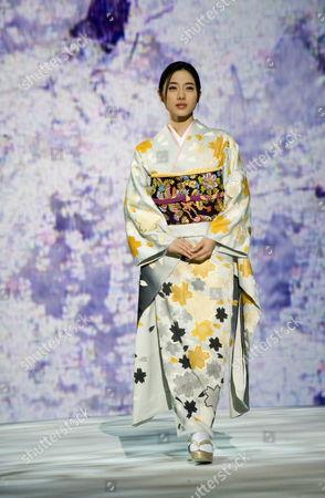 Leading Japanese Actress Satomi Ishihara Models the Latest Kimono Designs by Legendary Kimono Fashion Designer Kyoko Koizumi During Her 'Embracing Japanese Beauty' Fashion Show in Tokyo Japan 05 November 2009 Koizumi Has Been Designing Innovative Kimono For Over Sixty Years