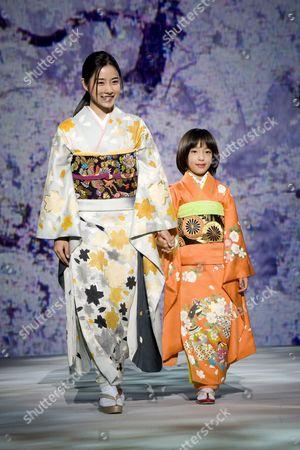 Leading Japanese Actress Satomi Ishihara (l) Models the Latest Kimono Designs by Legendary Kimono Fashion Designer Kyoko Koizumi During Her 'Embracing Japanese Beauty' Fashion Show in Tokyo Japan 05 November 2009 Koizumi Has Been Designing Innovative Kimono For Over Sixty Years