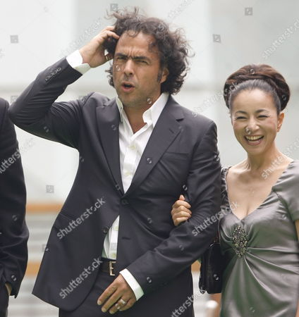 Stock Image of Mexican Film Director and President of the International Competition Jury For the 22nd Tokyo International Film Festival Alejandro Gonzalez Inarritu (l) Reacts As He Stands On the Green Carpet with Japanese Actress and a Jury For the International Competition Mieko Harada (r) During the Green Carpet Event For the 22nd Tokyo International Film Festival in Tokyo Japan 25 October 2009