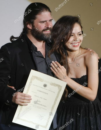 Stock Picture of Ecuadorian Film Director Sebastian Cordero (l) and a Colombian Actress and a Cast Member Martina Garcia (r) Pose On the Stage After Winning Special Jury Prize For Their Film 'Rabia' During the Award Ceremony of the 22nd Tokyo International Film Festival in Tokyo Japan 25 October 2009