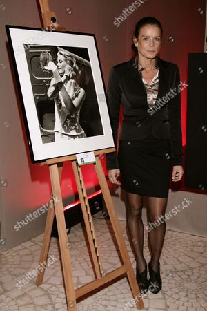 President of the Association 'Fight Aids Monaco' Princess Stephanie of Monaco Poses with a Photograph of Her Mother Grace Kelly by Edward Quinn During the Filming of 'To Catch a Thief' (1954) of Alfred Hitchcock in Cannes As She Attends the 'Fight Aids Monaco' Annual Charity Auction Sale at the Sea Club Meridien Hotel to Commemorate the World Aids Day in Monaco 01 December 2009