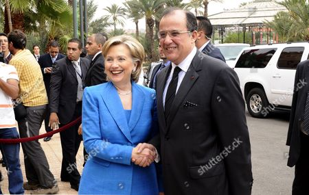 Us Secretary of State Hillary Clinton (l) Shakes Hands with Moroccan Minister of Foreign Affairs Taib Fassi Fihri As They Arrive at the Opening Ceremony of the Sixth Forum For the Future Held in Marrakech Morocco 03 November 2009 Clinton Arrived on 01 November in Morocco on the Next Stop in Her Diplomatic Mission to Relaunch the Middle East Peace Process Morocco Marrakesh