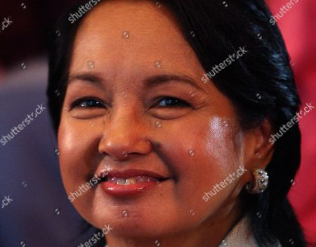 Stock Photo of Philippine President Gloria Macapagal-arroyo Chairperson Emeritus of Lakas-kampi-cmd Party During the Party's Convention at the Philippine International Convention Center Manila Philippines On 19 November 2009 Presidential Bet Gilberto Teodoro and Vice-presidential Bet Actor Eduardo Manzano Were Formally Nominated by the Party For the 2010 Elections
