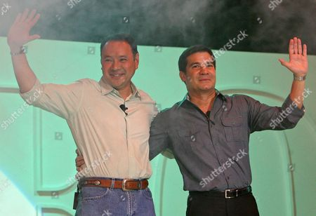 Former Secretary of National Defense and Presidential Bet Gilberto Teodoro (l) and Vice-presidential Bet Eduardo Manzano (r) Wave to the Crowd During the Lakas-kampi-cmd Party's Convention at the Philippine International Convention Center Manila Philippines On 19 November 2009 Teodoro Together with Vice-presidential Bet Actor Edu Manzano Were Formally Nominated by the Party For the 2010 Elections