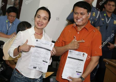 Presidential Candidate Senator Manny Villar (r) Holds Up His Certificate of Candidacy For 2010 Presidential Race Next to His Vice-president Loren Legarda (l) Inside the Commission on Elections (comelec) in Manila Philippines on 30 November 2009 Villar is the Only Presidential Aspirant who Experienced How to Live in Poverty Made His Fortune As a Real Estate Developer and Became the Richest Legislator Philippines Manila