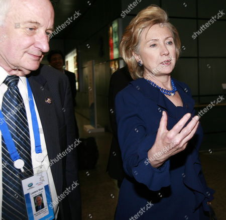 U S Secretary of State Hillary Clinton (r) Walks with U S Representative From Michigan Sander Martin Levin (l) On Their Way to Attend the Foreign Ministerial Meeting at the Asia-pacific Economic Cooperation (apec) in Singapore On 11 November 2009 the Singapore Summit is Set to Culminate When the Leaders of the Member Economies - Including Us President Barack Obama - Come Together in the City State On 14 and 15 November Apec Consists of 21 Pacific Rim Economies: Australia Brunei Canada Chile China Indonesia Hong Kong Japan Malaysia Mexico New Zealand Papua New Guinea the Philippines Singapore South Korea Taiwan Thailand Peru Russia the United States and Vietnam